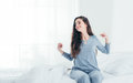Girl waking up and stretching Royalty Free Stock Photo