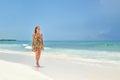 Girl walking at the beach Royalty Free Stock Photo