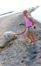 Girl walking dog Royalty Free Stock Photography