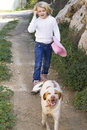 Girl walking dog Royalty Free Stock Photo