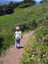 Girl walking down path Royalty Free Stock Photo