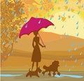 Girl walking with her dogs in autumn