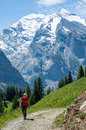 Girl walking in the Mountains Royalty Free Stock Photo