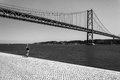 Girl walking near the Vasco Da Gama bridge Royalty Free Stock Photo