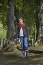 Girl walking on a path in the forest with scarf Royalty Free Stock Photo