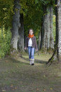 Girl walking on a path in the forest with scarf Royalty Free Stock Photography