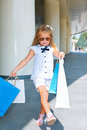 Girl walking with shopping bags cheerful preschool Royalty Free Stock Images