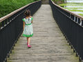 Girl Walking  On The Wooden Fo...