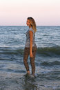 Girl walks into the sea Stock Photography