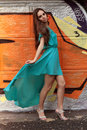 The girl at a wall young in long blue dress stands about painted graffiti Royalty Free Stock Photos