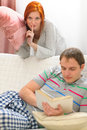Girl want to start pillow fight with boyfriend Royalty Free Stock Photos