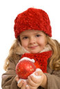 Girl with warm clothes holding christmas ball Royalty Free Stock Photo