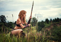 Girl warrior on patrol beautiful red haired in the image of ancient warriors the background of nature Stock Photography