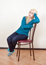 The girl was asleep sitting on a chair Royalty Free Stock Photo