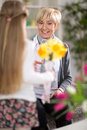 Girl was surprised his grandmother with flowers little bouquet of Stock Photography