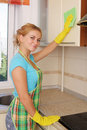 Girl washes kitchen set Stock Image