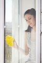 Girl washes a window the young carefully and cleans Stock Photography