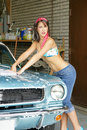 Girl washing car Stock Photos
