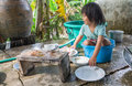 Girl washing dishes the is Stock Photo