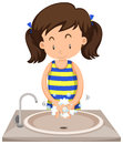 Girl washing hands in the sink