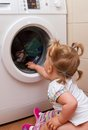 Girl with washing machine Royalty Free Stock Photo