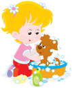 Girl washing a puppy little washes her small pup in basin with lather Stock Images