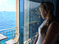 Girl Watch sea from the balcony. Royalty Free Stock Photo