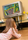 Girl watch TV Royalty Free Stock Photo