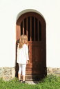 Girl watching behind door Royalty Free Stock Photo