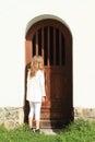 Girl watching behind door Royalty Free Stock Photo