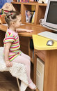 Girl watching cartoons Royalty Free Stock Images