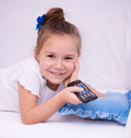 Girl watching tv happy remote control Royalty Free Stock Image