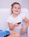 Girl watching tv happy remote control Stock Photography
