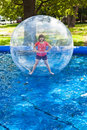Girl in water ball open swimming pool Stock Photography