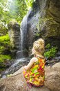 Girl at waterfall Royalty Free Stock Photo