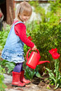 GIrl with watering can Royalty Free Stock Photos