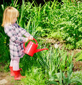 Girl with watering can Royalty Free Stock Images