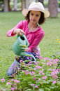 Girl with watering can flowers Stock Images