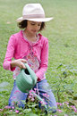 Girl with watering can flowers Royalty Free Stock Photography