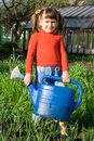 Girl with watering can on the vegetable garden Royalty Free Stock Photo