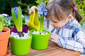 Girl watering flowers Royalty Free Stock Photo