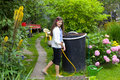 Girl watering flowers in garden Royalty Free Stock Photo