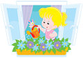 Girl watering flowers little on a windowsill Stock Photo