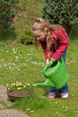 Girl watering garden flowers Royalty Free Stock Photography