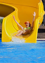 Girl on a waterslide Stock Photos