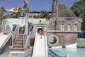 Girl on waterslide Royalty Free Stock Photo
