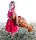 The girl with a wattled jug barefoot on hay Stock Image