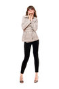 Girl wearing a coat and black leggings. Isolated Royalty Free Stock Photography
