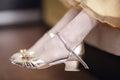 Girl wearing elegant gold sandals Royalty Free Stock Photo