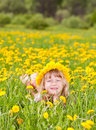 Girl wearing floral wreath outdoors portrait of cute little with dandelion enjoying a summer day Stock Images